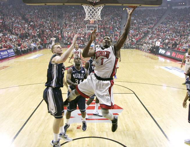 UNLV forward Quintrell Thomas lays in two points while being defended by UNR forward Kevin Panzer during their game Tuesday, Jan. 29, 2013 at the Thomas & Mack. UNLV won the game 66-54.
