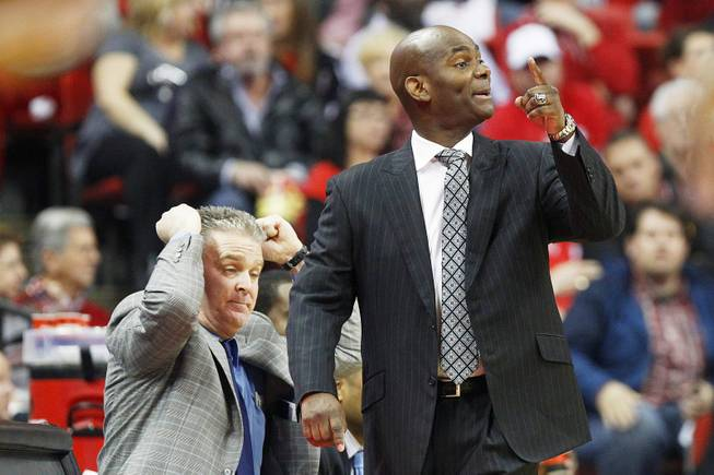 UNR coach David Carter talks to his team during their game against UNLV Tuesday, Jan. 29, 2013 at the Thomas & Mack. UNLV won the game 66-54.