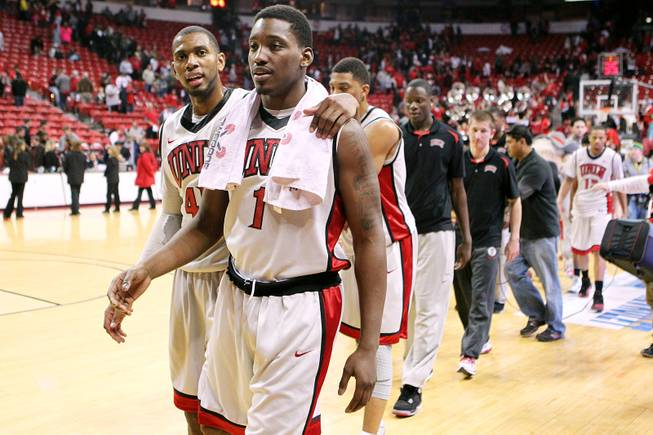 UNLV forwards Mike Moser and Quintrell Thomas head off the floor after their 66-54 win over UNR Tuesday, Jan. 29, 2013 at the Thomas & Mack.