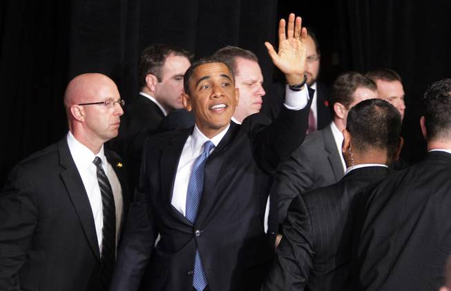 President Barack Obama waves to the crowd after speaking about immigration reform at Del Sol High School in Las Vegas on Tuesday, January 29, 2013.