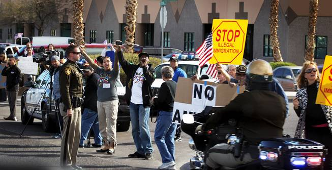 Protesters demonstrate outside of Del Sol High School in Las Vegas where President Barack Obama will speak about immigration reform on Tuesday, January 29, 2013.
