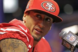 San Francisco 49ers quarterback Colin Kaepernick answers reporters' questions during media day Tuesday, Jan. 29, 2013, for Super Bowl XLVII in New Orleans.