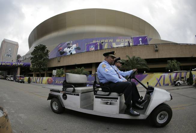 New Orleans police officers drive past the Superdome where the San Francisco 49ers and the Baltimore Ravens will play the NFL Super Bowl XLVII football game, Tuesday, Jan. 29, 2013, in New Orleans.