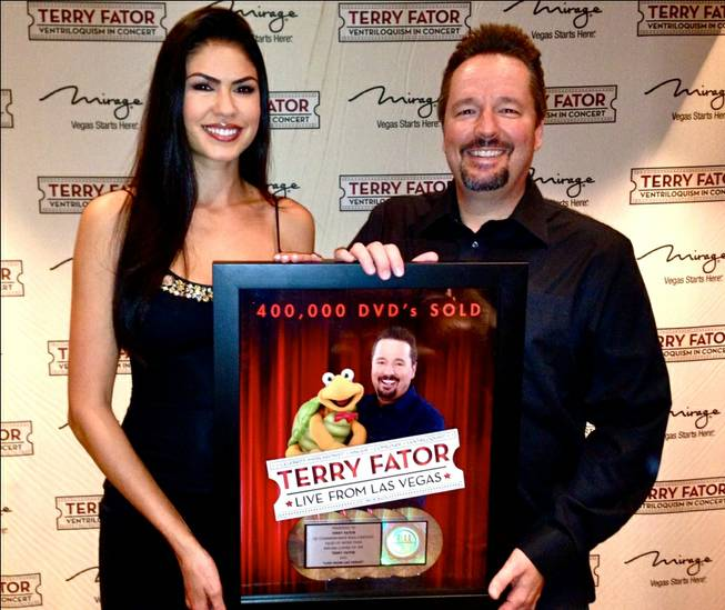 Taylor Makakoa and Terry Fator celebrate his DVD being certified quadruple platinum (400,00 copies sold).