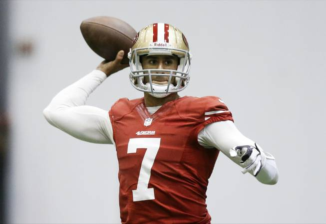 San Francisco 49ers quarterback Colin Kaepernick passes during practice on Wednesday, Jan. 30, 2013, in New Orleans.
