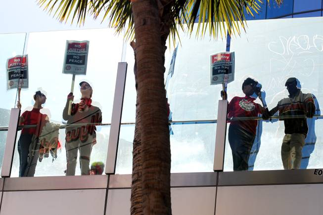 Culinary Local 226 members picket outside of Cosmopolitan Thursday, Jan. 31, 2013.