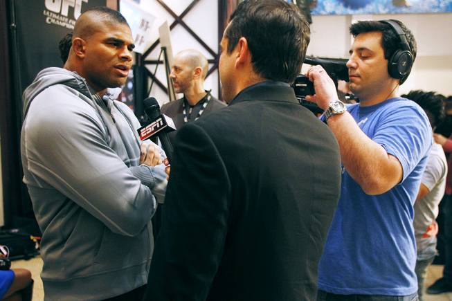 Alistair Overeem talks to a television reporter during the news conference for UFC 156 Thursday, Jan. 31, 2013.