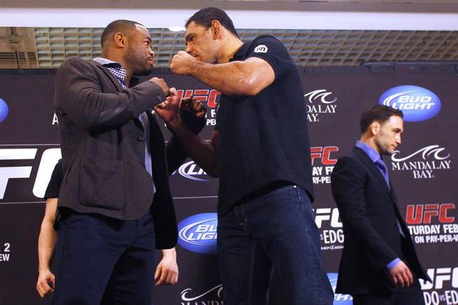Rashad Evans, left, and Antonio Rogerio Nogueira face off during the news conference for UFC 156 Thursday, Jan. 31, 2013.