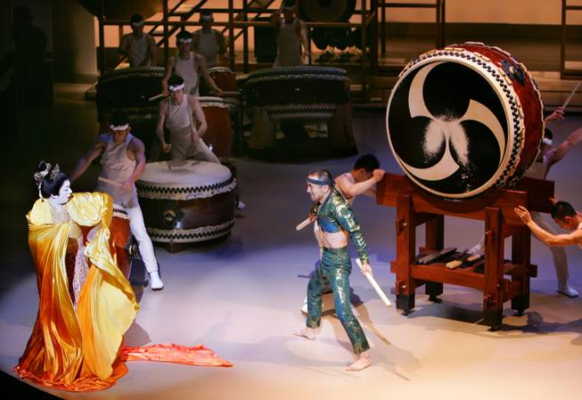 "Japan's Kabuki star Tamasaburo Bando, left, performs with Yoshikazu Fujimoto of Japanese ""Taiko"" drum troupe Kodo, center, and other Kodo members during a preview of his self-produced play ""Amaterasu"" with Japanese ""taiko"" drum troup Kodo drummers at a Tokyo theater Wednesday, May 10, 2006."