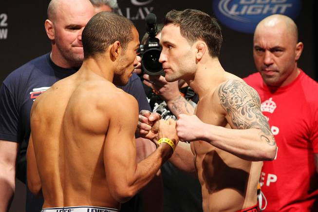 Lightweight champion Jose Aldo, left, and challenger Frankie Edgar face off during weigh ins for UFC 156 Friday, Feb. 1, 2013.