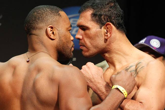 Light heavyweights Rashad Evans, left, and Antonio Rogerio Nogueira face off during weigh ins for UFC 156 Friday, Feb. 1, 2013.