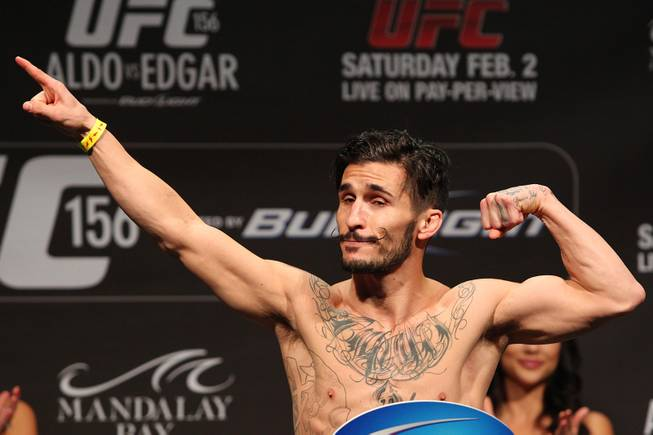 Ian McCall poses during weigh ins for UFC 156 Friday, Feb. 1, 2013.