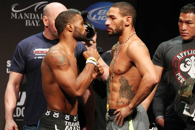 Tyron Woodley, left, and Jay Hieron face off during weigh ins for UFC 156 Friday, Feb. 1, 2013.