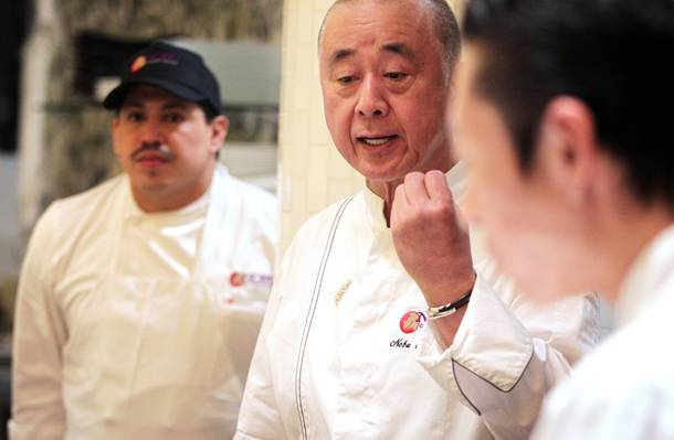 Chef Nobu Matsuhisa talks to his staff at the new Nobu Restaurant at Caesars Palace in Las Vegas on Friday, Feb. 1, 2013.