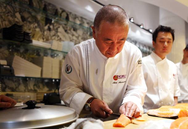 Chef Nobu Matsuhisa prepares fresh salmon for poaching at the new Nobu Restaurant at Caesars Palace in Las Vegas on Friday, February 1, 2013.
