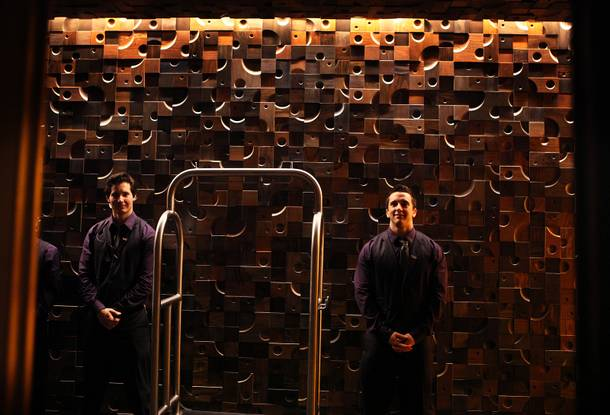Bellmen Zerin Marglin, left, and Daniel Walter wait in the lobby of the new Nobu Hotel at Caesars Palace in Las Vegas on Friday, February 1, 2013.