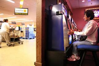 A woman, who did not want her name used, plays slots in the Golden Gaming area inside a Vons Supermarket in Las Vegas on Friday, February  1, 2013.