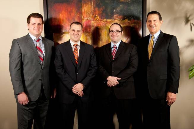 Jeffrey Burr & Associates attorneys, from left, Collins Hunsaker, Jason Walker, Corey Schmutz and Jeff Burr pose in the Law Firm of Jeffrey Burr & Associates, 2600 Paseo Verde Parkway, Henderson, Tuesday, January 29, 2013.