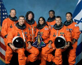 This photo released by NASA shows STS-107 crew members in their group photo. Space Shuttle Columbia crew, left to right, front row, Rick Husband, Kalpana Chawla, William McCool, back row, David Brown, Laurel Clark, Michael Anderson and Israeli astronaut Ilan Ramon are shown in this undated crew photo. NASA declared an emergency and feared the worst after losing communication with space shuttle Columbia as the ship and its seven astronauts soared over Texas several minutes before its expected landing Saturday, Feb. 1, 2003.