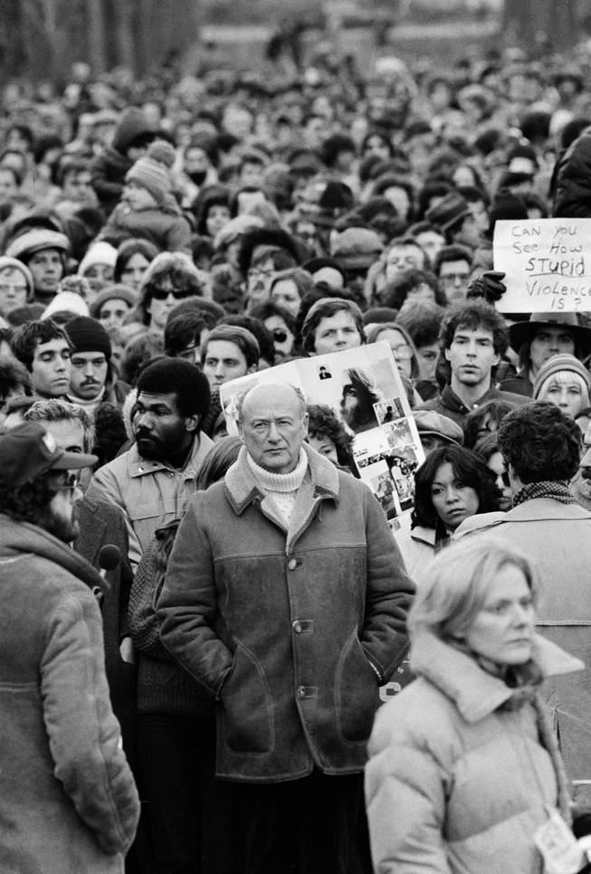 In this Dec. 14, 1980, file photo, New York Mayor Ed Koch stands among Beatles' fans paying tribute to the late John Lennon during a silent vigil that was called by Mayor Koch in New York's Central Park.