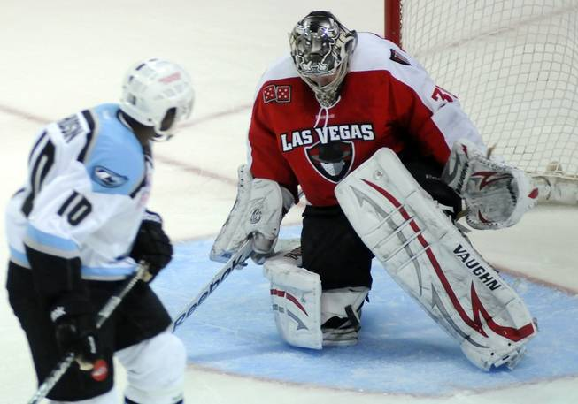 Wranglers netminder Joe Fallon drops the puck to the ice after stopping a shootout attempt by Aces forward Alex Hudson to give Las Vegas a thrilling 5-4 victory on Friday night at the Orleans Arena.