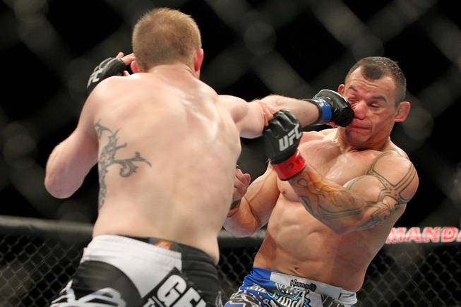 Gleison Tibau gets hit with a right from Evan Dunham during their bout at UFC 156 Saturday, Feb. 2, 2013 at the Mandalay Bay Events Center. Dunham won a split decision.