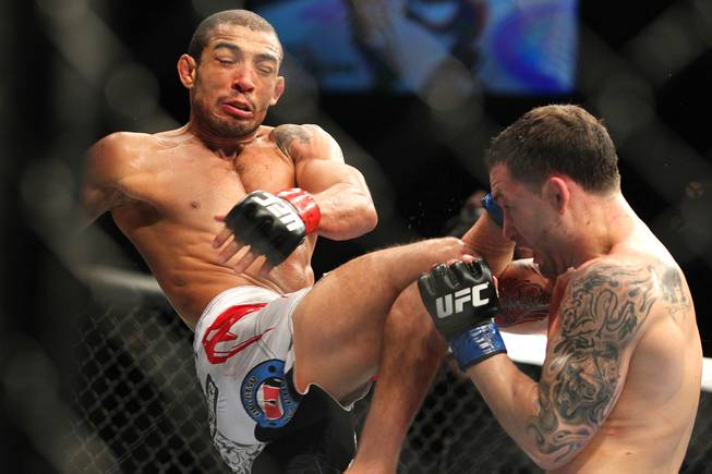 Jose Aldo throws a knee at Frankie Edgar during their featherweight title fight at UFC 156 Saturday, Feb. 2, 2013 at the Mandalay Bay Events Center. Aldo retained his title with a unanimous decision.
