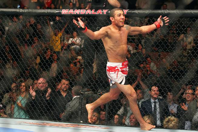 Jose Aldo reacts after retaining his featherweight belt after winning a unanimous decision over Frankie Edgar at UFC 156 Saturday, Feb. 2, 2013 at the Mandalay Bay Events Center.