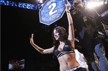 Octagon girl Arianny Celeste waves to fans between rounds of a fight at UFC 156 on Saturday, Feb. 2, 2013, at Mandalay Bay Events Center.