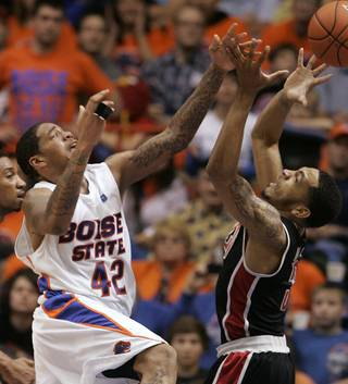 UNLV's Anthony Marshall (3) and Boise State's Kenny Buckner (42) go after a rebound during the second half of an NCAA college basketball game, Saturday, Feb. 2, 2013, in Boise, Idaho. Boise State won 77-72. (AP Photo/Matt Cilley)