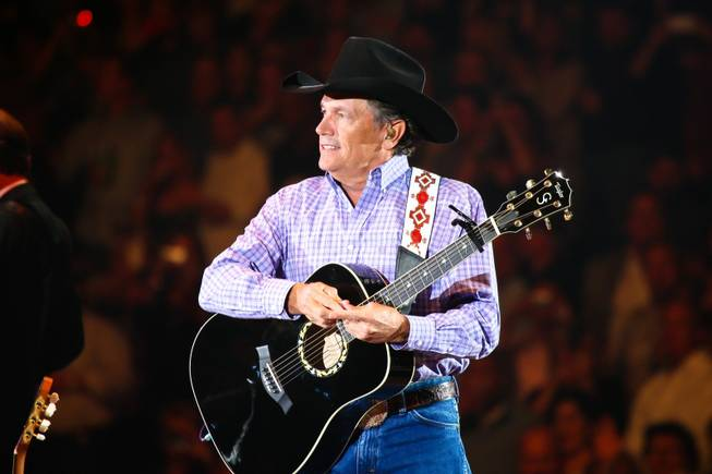 Country icon George Strait performs for the last time in Las Vegas for a sold-out crowd while on the road during his final tour -- The Cowboy Rides Away -- at the MGM Grand Garden Arena in Las Vegas, Saturday, February 2, 2013.