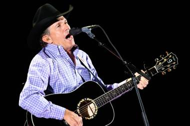 "Country music icon George Strait performs for a sold-out crowd during his final tour, ""The Cowboy Rides Away,"" at MGM Grand Garden Arena on Saturday, Feb. 2, 2013, in Las Vegas."