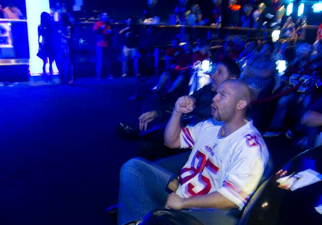Greg (no last name given) from San Francisco cheers on the San Francisco 49ers during a Super Sunday party at the Sapphire Las Vegas strip club Sunday, Feb. 3, 2013.