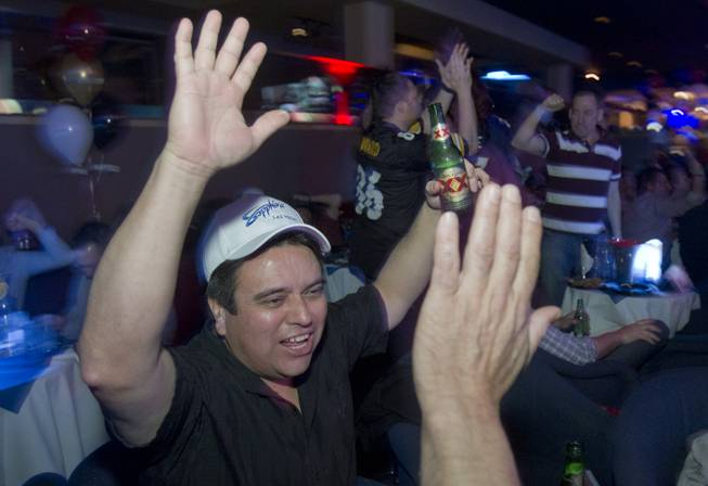 Art Trejo of Chino Hills, Calif. celebrates a Ravens touchdown during a Super Sunday party at the Sapphire Las Vegas strip club Sunday, Feb. 3, 2013. Trejo was also celebrating his birthday, he said.