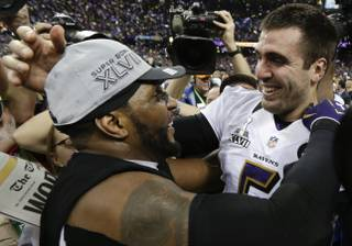 Baltimore Ravens linebacker Ray Lewis and quarterback Joe Flacco celebrate their 34-31 win against the San Francisco 49ers in Super Bowl XLVII at the Mercedes-Benz Superdome in New Orleans on Sunday, Feb. 3, 2013.