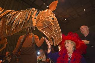 Mary Stopa gets a close-up look at Joey, the puppet horse from