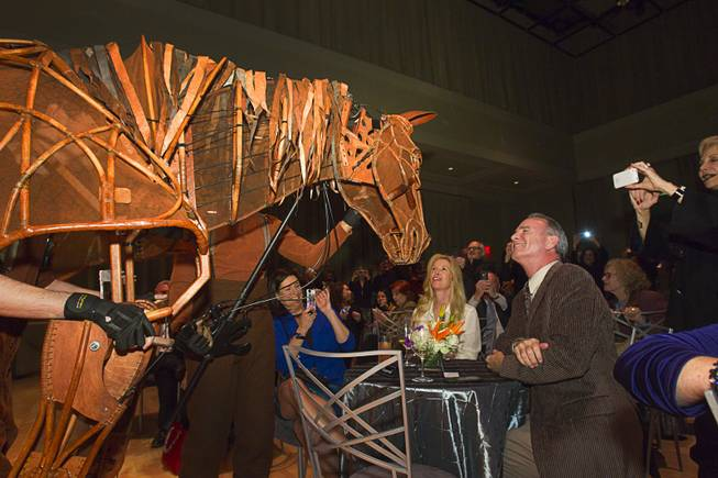 "Gary Ackerman and his wife Debra get a close-up look at Joey, the puppet horse from ""War Horse,"" during a donors reception at The Smith Center for the Performing Arts on Monday, Feb. 4, 2013. ""War Horse"" is at The Smith Center from Oct. 2-6."