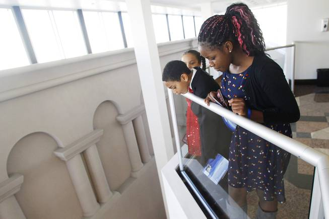 Assemblyman William Horne's children, from left, Chloe, Henry and Quyncee Horne, take in the view from a fourth floor railing of the Nevada Legislative Building on the first day of the 2013 legislative session Monday, Feb. 4, 2013 in Carson City.