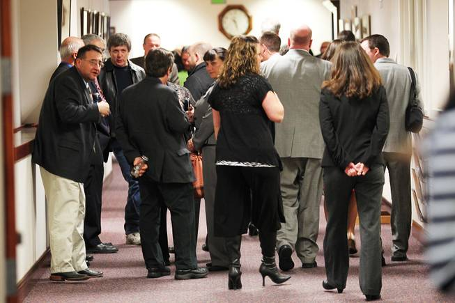 People clog a hallway in the Nevada Legislative Building on the first day of the 2013 legislative session Monday, Feb. 4, 2013 in Carson City.