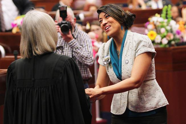 Assemblywoman Lucy Flores greets Nevada Supreme Court Chief Justice Kristina Pickering on the first day of the 2013 legislative session Monday, Feb. 4, 2013 in Carson City.