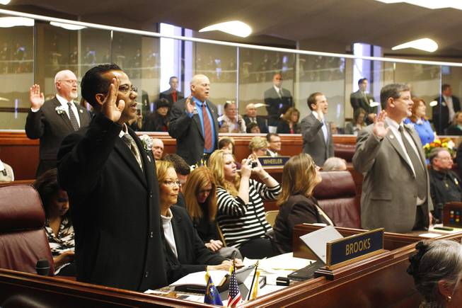 Assemblyman Steven Brooks is sworn in along with the rest of the assembly on the first day of the 2013 legislative session Monday, Feb. 4, 2013 in Carson City.