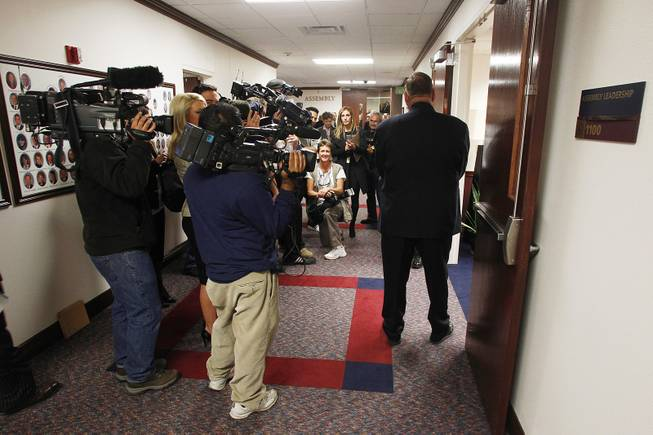 Members of the media wait outside the Assembly Leadership Office for Assemblyman Steven Brooks to emerge from a meeting on the first day of the 2013 legislative session Monday, Feb. 4, 2013 in Carson City.