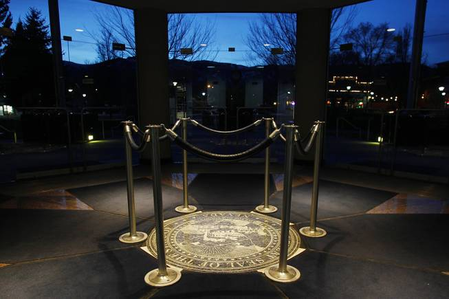 A carved Nevada state seal is protected by stanchions in the entry of the Legislative Building at the end of the first day of the 2013 legislative session Monday, Feb. 4, 2013 in Carson City.