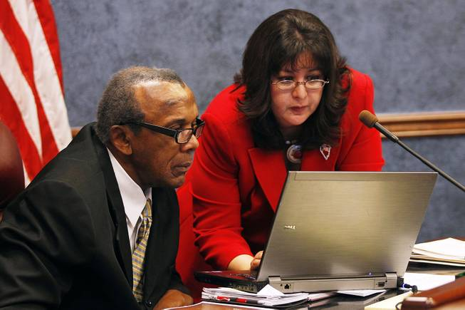 Assemblyman Harvy Munford and Irene Bustamante Adams look at a computer during a meeting of the Government Affairs Committee on the second day of the 2013 legislative session Tuesday, Feb. 5, 2013 in Carson City.