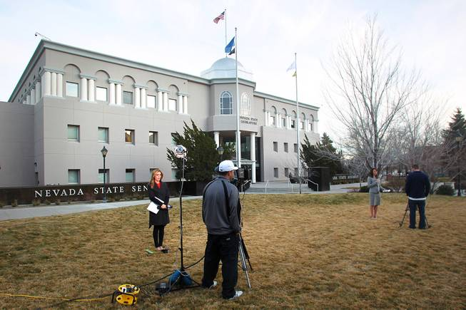 Television reporters do live shots in front of the Legislative Building on the second day of the 2013 legislative session Tuesday, Feb. 5, 2013 in Carson City.