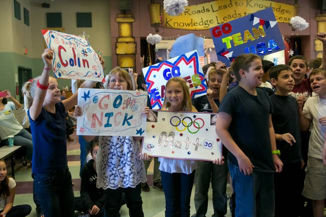 Students at Glen Taylor Elementary School welcome the USA Eagels Rugby Team, Tuesday Feb. 5, 2013.