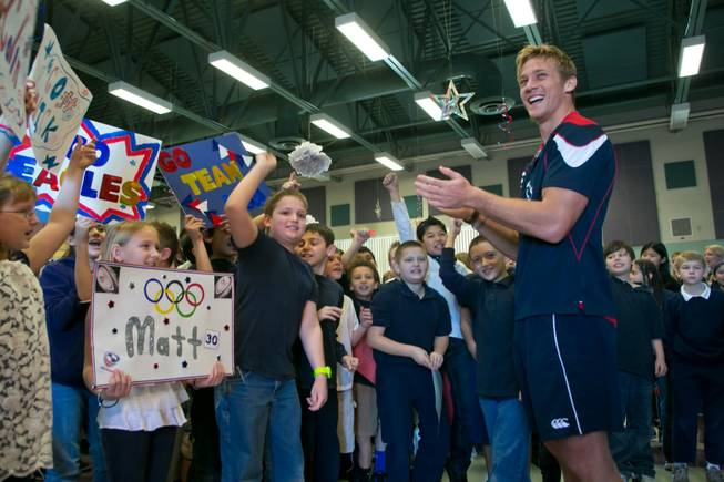 Colin Hawley of the USA Eagels Rugby Team visits with students at Glen Taylor Elementary School, Tuesday Feb. 5, 2013.