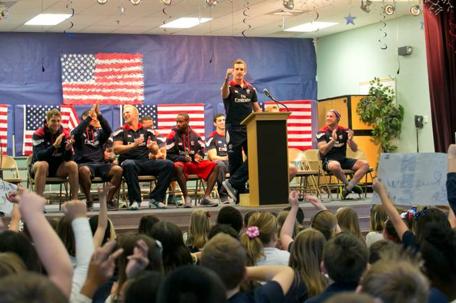 Zachary Test of the USA Eagels Rugby Team answers questions from students during a pep rally at Glen Taylor Elementary School, Tuesday Feb. 5, 2013.