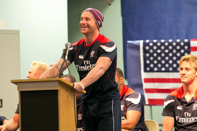 Luke Hume of the USA Eagels Rugby Team answers questions from students during a pep rally at Glen Taylor Elementary School, Tuesday Feb. 5, 2013.