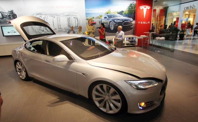A Tesla Model S is shown in the showroom at the Washington Square Mall, July 20, 2012, in Portland, Ore. Tesla Motors produces electric cars that can go from zero to 60 mph in less than six seconds, all without a drop of gasoline.